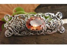 VENUS - srebrna broszka z topazem złocistym